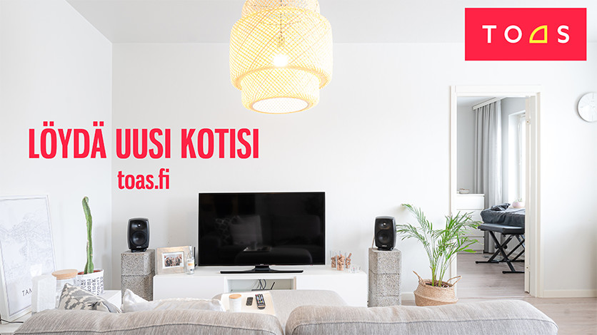 Find your new home at toas.fi. In the background a picture of a living room.
